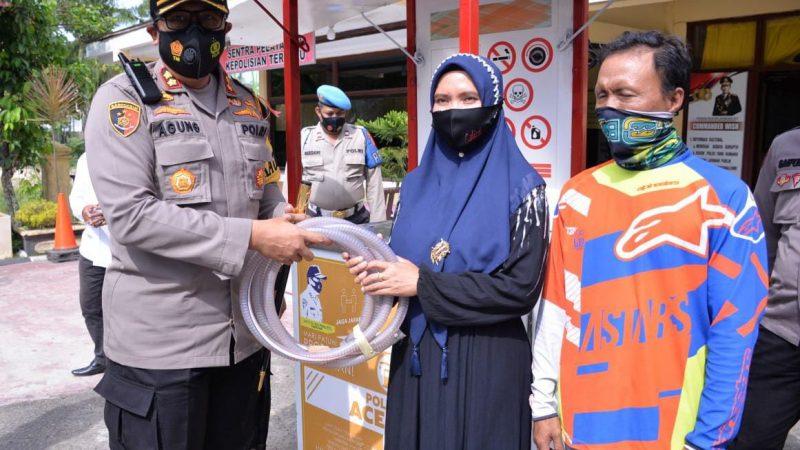 Kapolres Langsa Menyerahkan Pertamini Bantuan Kapolda Aceh Kepada Masyarakat