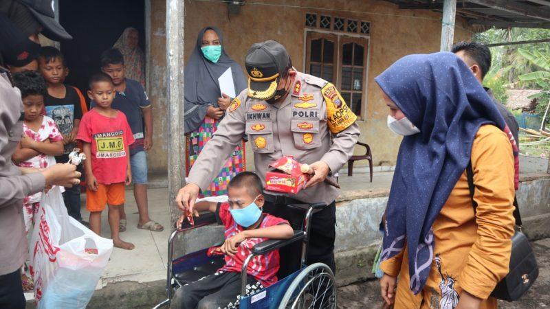 Kapolres Batu Bara Kunjungi Anak Penyandang Disabilitas Beri Kursi Roda